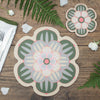 Flower shaped placemat and coaster with a succulent design in Subtle Green colour way by Beyond the Fridge