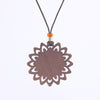 sun design walnut pendant necklace view from back