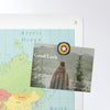 world map design magnetic notice board with a postcard attached with a millefiori fridge magnet