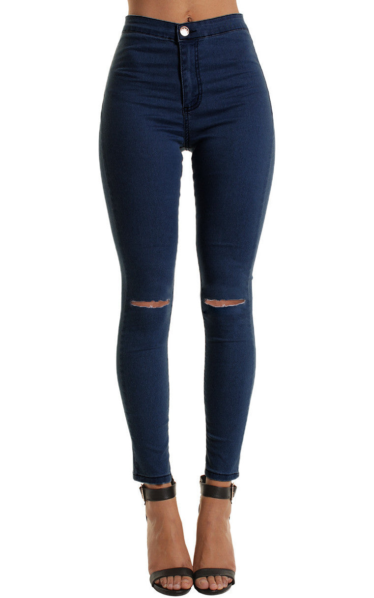 The perfect high waist jean features a skinny leg, solid exterior, and 5 pocket.