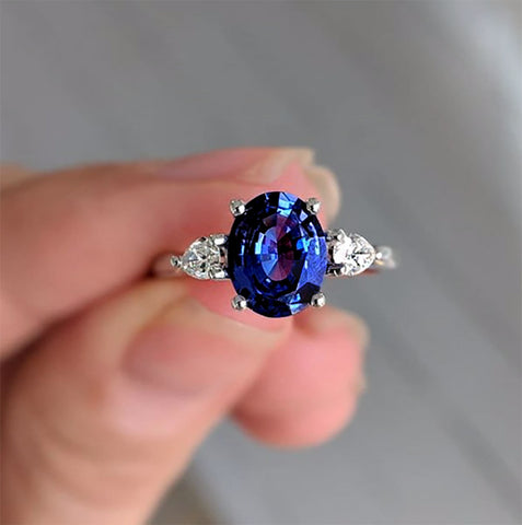 Sapphire engagement ring pear shaped diamonds