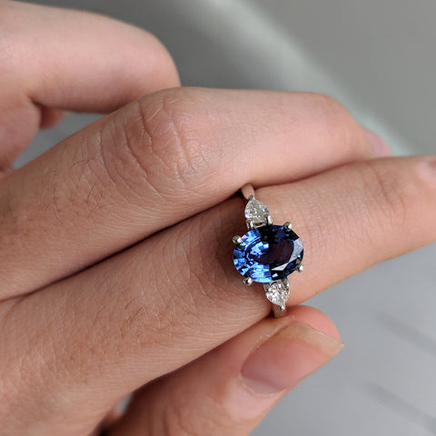 Bespoke engagement ring in blue sapphire and diamonds