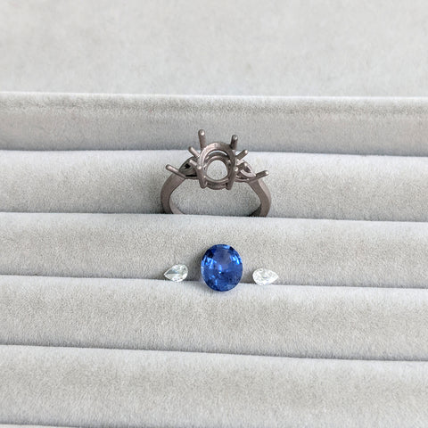 white gold ring setting and sapphire and diamond stones