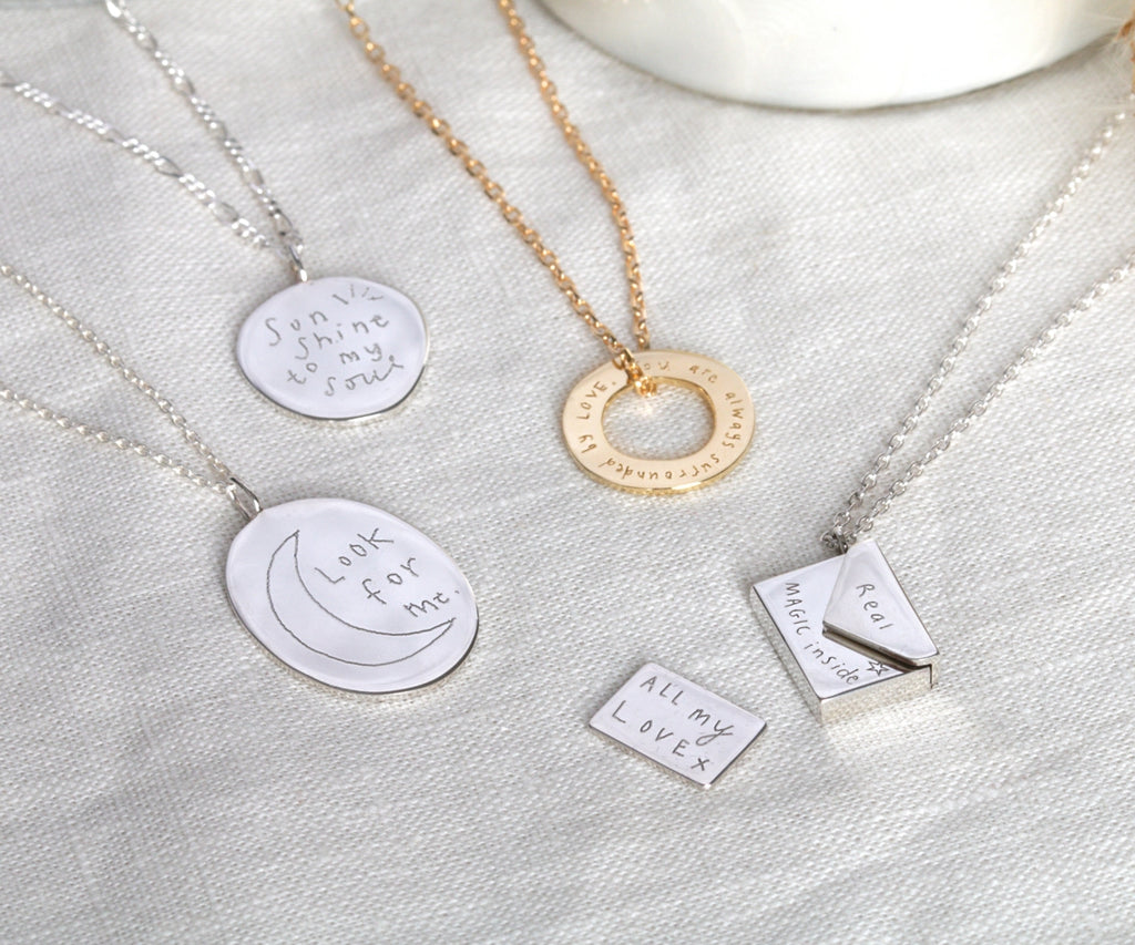silver envelope locket necklace with letter inside by sketchy muma in collaboration with maya magal london uk