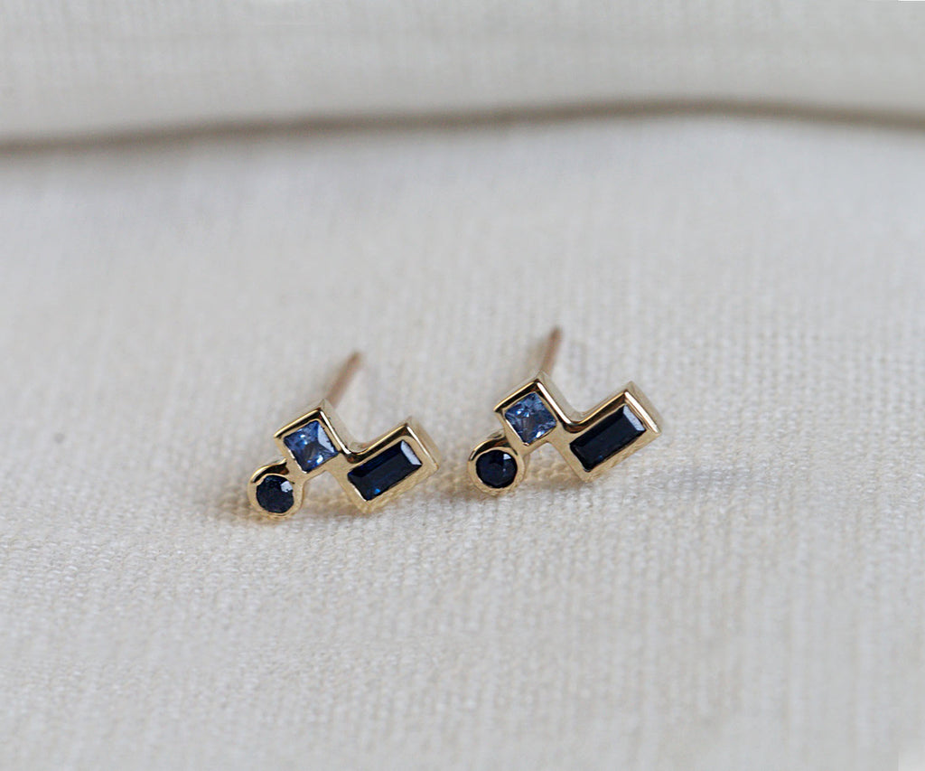 blue sapphire earrings cluster with brilliant cut and princess cut sapphire stone set in 9ct yellow solid gold, handmade in London, UK, part of Sapphire collection, Maya Magal luxury jewellery brand