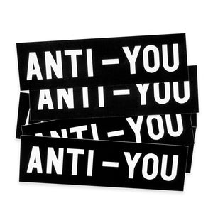 "A pile of the No Fun Press ""Anti-You"" bumper stickers."