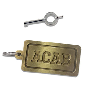 "Photo show the brass ""ACAB"" keychain as well as an authentic handcuff key.  The font is engraved in the brass tag with a thick border which is also engraved."