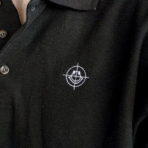 "Detail of the embroidery on the black ""Target"" polo."