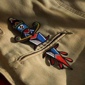 "Original ""Dagger"" two-part embroidered iron-on patch on a canvas jacket."