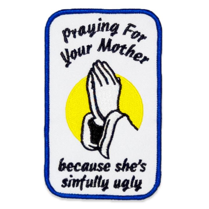"Original ""Prayer"" embroidered iron-on patch from NO FUN®. Patch depicts praying hands with the text ""praying for your mother ... because she's sinfully ugly"""