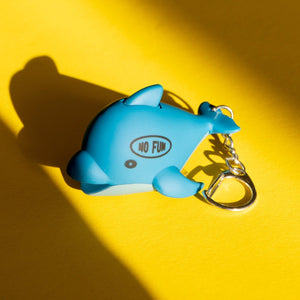 Dolphin keychain that lights up when pressed. No Fun® logo on left side of dolphin.