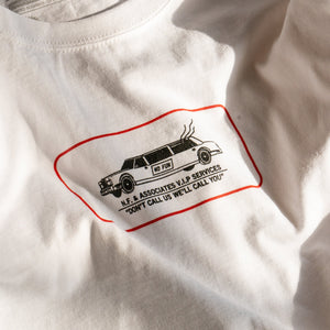"Close up of the ""Luxury Services"" print on a white t-shirt."