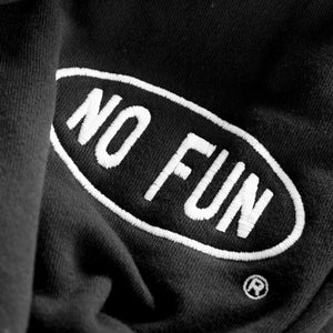 """NO FUN®"" official studio sweatpants close up photo.  Sweatpants are unisex and feature a drawstring waistband and cuffed leg opening. The ""NO FUN®"" logo is embroidered in white."