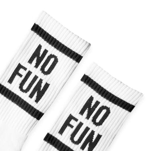 "Detail photo of our signature NO FUN® crew socks. 100% Pima cotton, woven in the United States. The socks are white and feature ""NO FUN®"" logo in black on both the leg, and toe cap of the socks."
