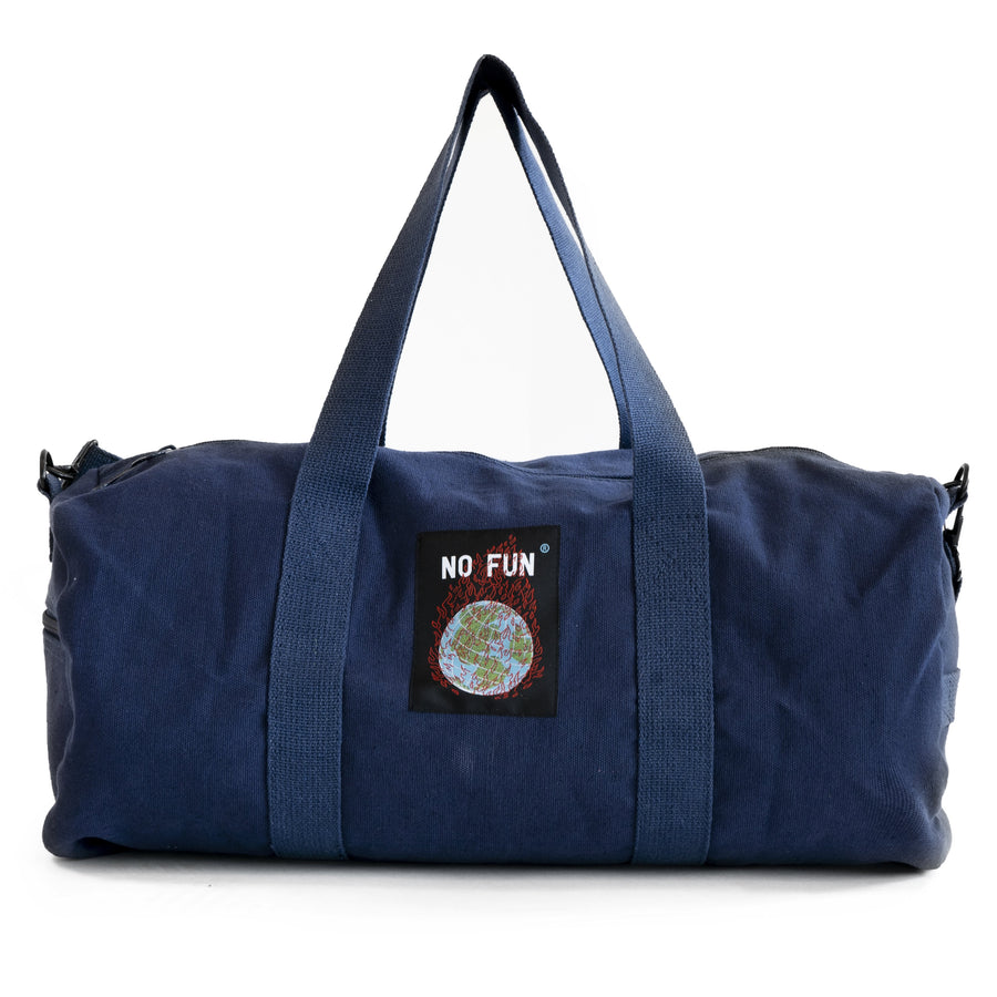 "The ""Life Is Hell"" duffle from No Fun Press. Navy duffle bag, with red embroidered text saying ""life is hell""."