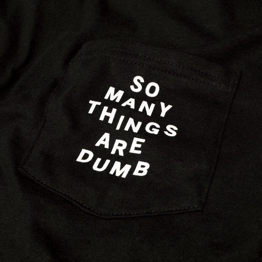 "Photo of the original NO FUN® ""So Many Things Are Dumb"" Pocket tee, designed and printed in Toronto.  T-shirt features front pocket and white text that reads ""SO MANY THINGS ARE DUMB""."