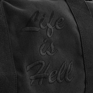 "A detail of the embroidery on the black ""life is hell"" duffle bag."