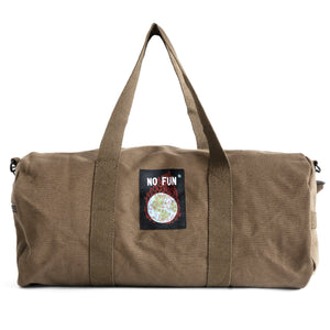 "The ""Life Is Hell"" duffle from No Fun Press. Brown duffle bag, with an embroidered tag showing a burning globe.."