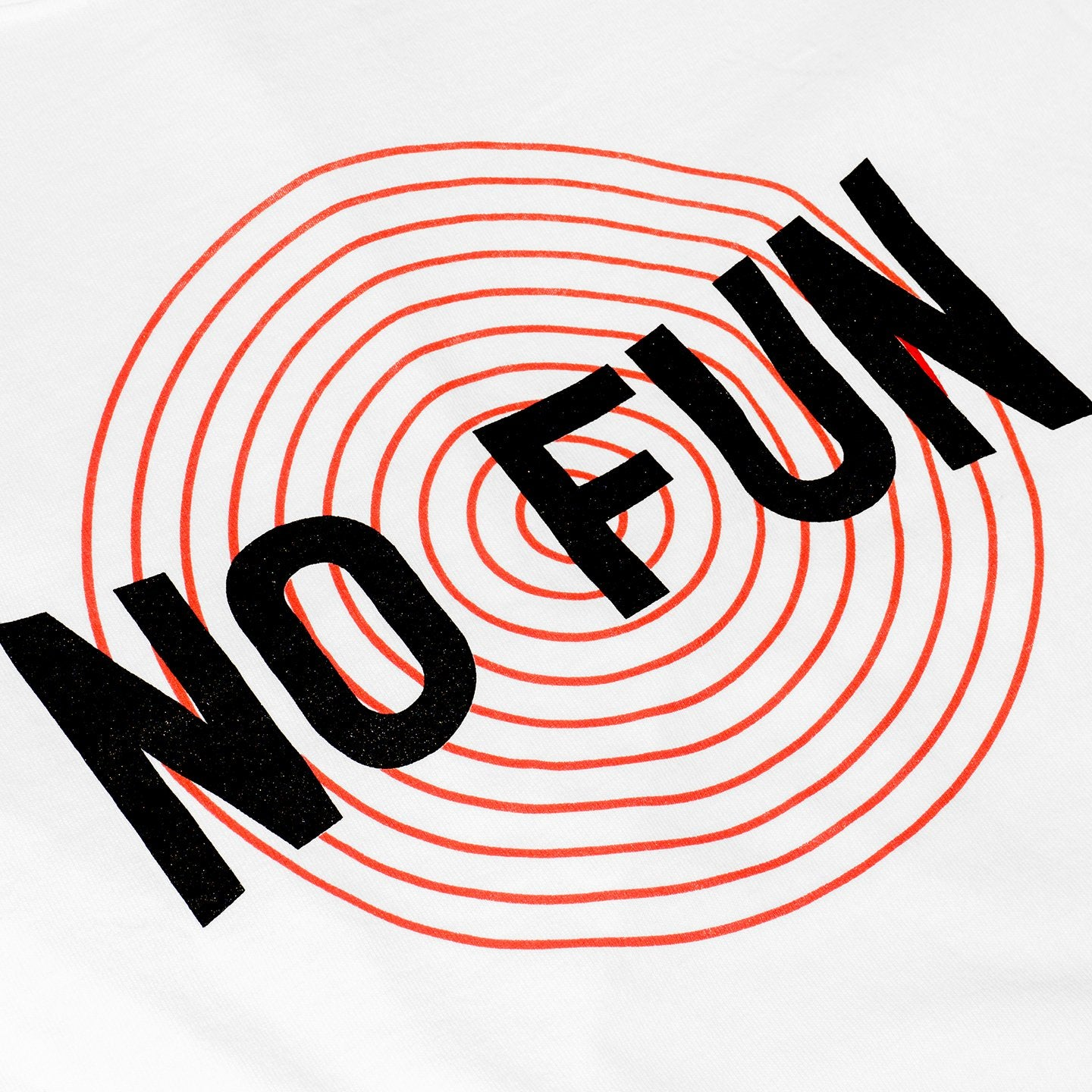 "Detail of No Fun Press ""Circles"" Shirt. Red concentric circles with black No Fun logo on top."