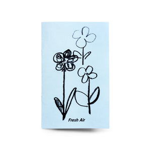 "Cover of ""Fresh Air"" by Christian Stearry, a 20 page zine.  Photo features the cover of the zine, which showcases some illustrated flowers and the title ""Fresh Air""."