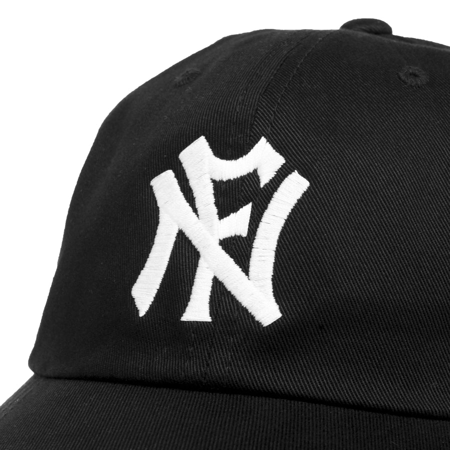 Black baseball cap featuring an embroidered N.F (No Fun®) logo in white, which references baseball logos.