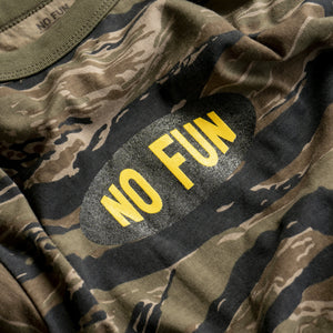 "Closeup detail of the ""No Fun®"" oval logo on the ""Invisible"" longsleeve shirt."