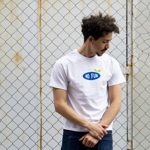"Man standing against a fence wearing the ""Grow Your Own"" t-shirt."