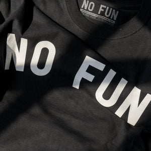 Detail of the No Fun® text across the classic t-shirt.
