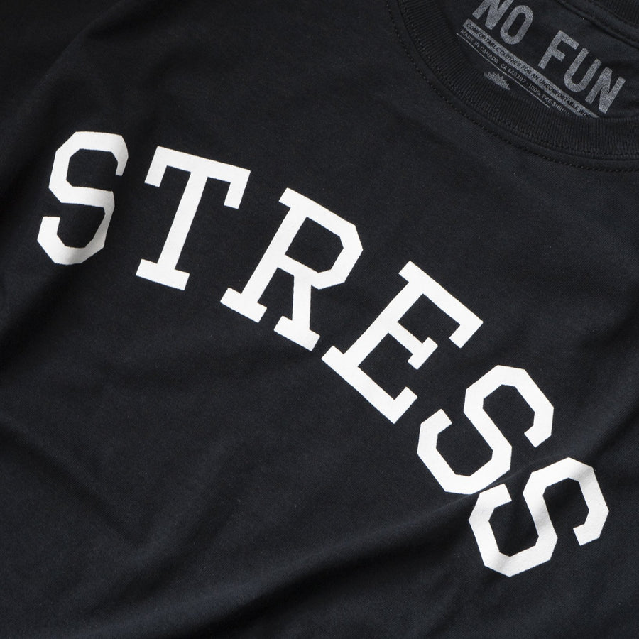 "Photo of the original NO FUN® ""STRESS"" t-shirt.  Shirt is black and features large white collegiate style text that reads ""STRESS"" across the front."