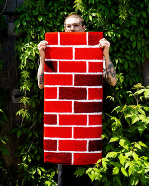 "Original ""So Many Things Are Dumb"" patch from ""NO FUN®"". Patch measures 3"" X 3.5"" and features white embroidered text on a black oval patch, with black embroidered edge. The patch is photographed on a white background, and can be stitched, or ironed on.  Patch is photographed against a wood background to show texture."