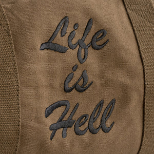 "A detail of the embroidery on the ""Life is Hell"" duffle bag."