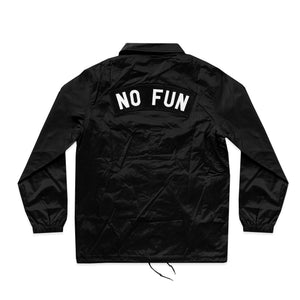 "Photo of the backside of the ""NO FUN®"" X ""Crawling Death"" coaches jacket. The jacket is black and features an oversized ""NO FUN®"" rocker patch that sits above the shoulder blades. The jacket utilizes snap closures and drawstring cords at the bottom."