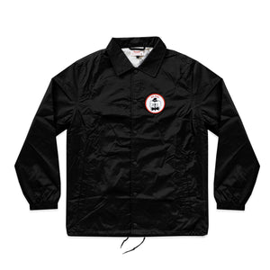 "Photo of the ""NO FUN®"" X ""Crawling Death"" coaches jacket.  The jacket is black and features a circular breast patch of an executioner in black and white.  The patch also has a red ""NO FUN®"" logo and a red border.  The jacket utilizes snap closures and drawstring cord."