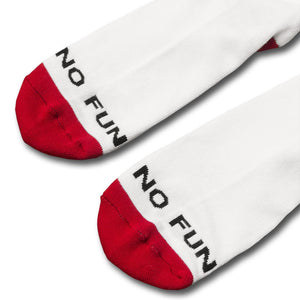 Detail of the toes of the Kilroy socks. Black No Fun® logo across the toes, with a red cap at the end of the socks.