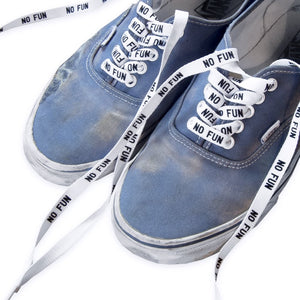 """No Fun"" shoelaces in beaten up old vans."