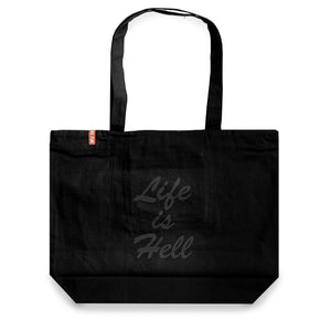 "Black high-quality tote bag with black text in a brush script that reads ""Life is hell"". Red No Fun® logo tag on the top left corner."