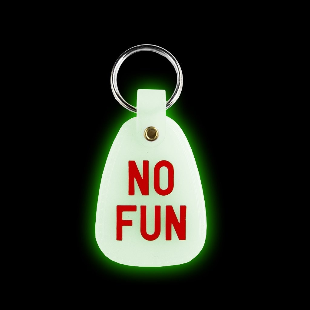 "No Fun Press ""Nite glow"" keychain - designed in Toronto. These are a red print on white ""nite glow"" plastic."