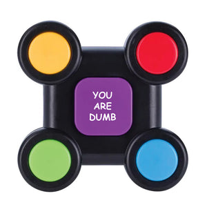 "Photo of the ""No Fun®"", ""You are Dumb"" Electronic memory game.  The game is black, with four different coloured buttons than can be found in each corner.  The buttons are yellow, red, green, and blue.  In the center of the game there is a larger square button that is purple, with the phrase ""YOU ARE DUMB"" printed in white text.  The memory game is photographed against a white background."