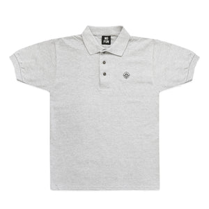 "Grey polo shirt with small embroidered ""Target"" logo from No Fun®. Embroidery is of a smiley face in a crosshair, sized 1.25"" diameter."