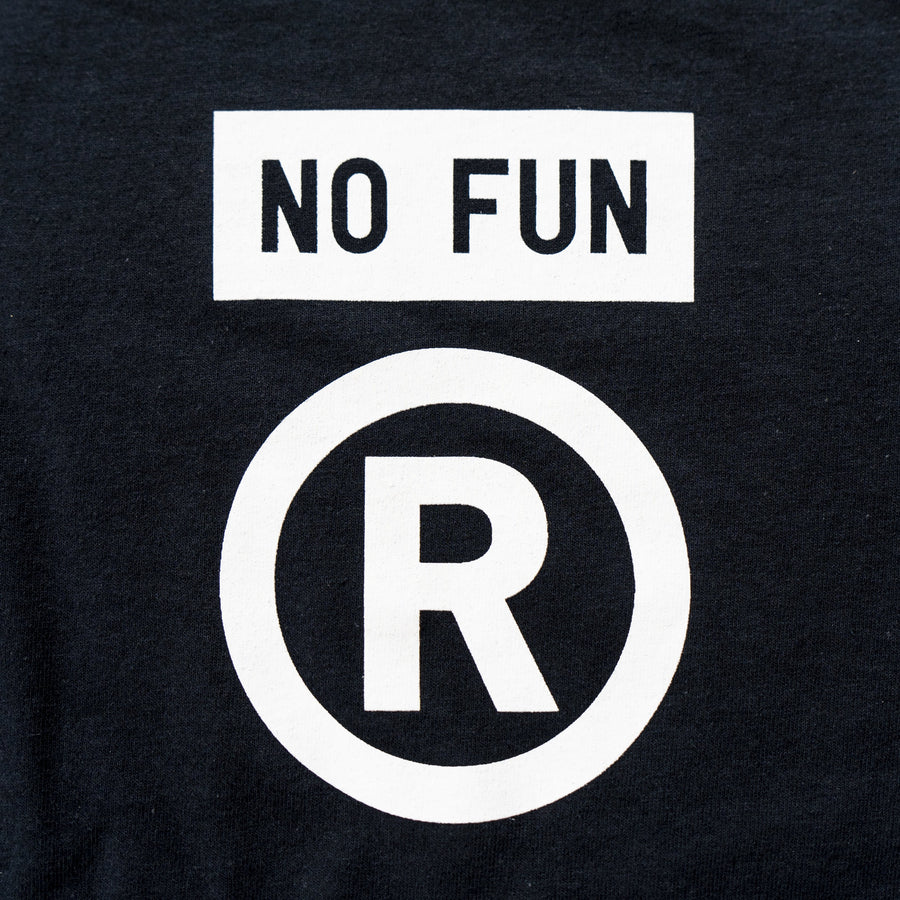 Black t-shirt with oversized pocket print of the registered trademark symbol and the No Fun® box logo. Celebrating the filing of No Fun's® trademark application.