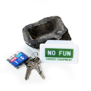 "No Fun Press Rock, designed in Toronto. Text on the cover of the secret compartment reads ""NO FUN - covert equipment"""