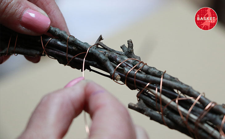 DIY Wishing Well: Twist or braid the twigs together with wire.