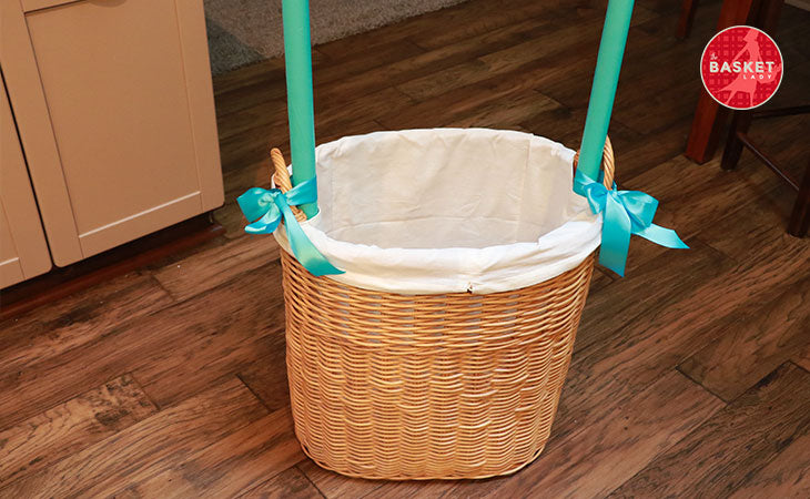 DIY Wishing Well: Secure the dowel rods to the basket weave.