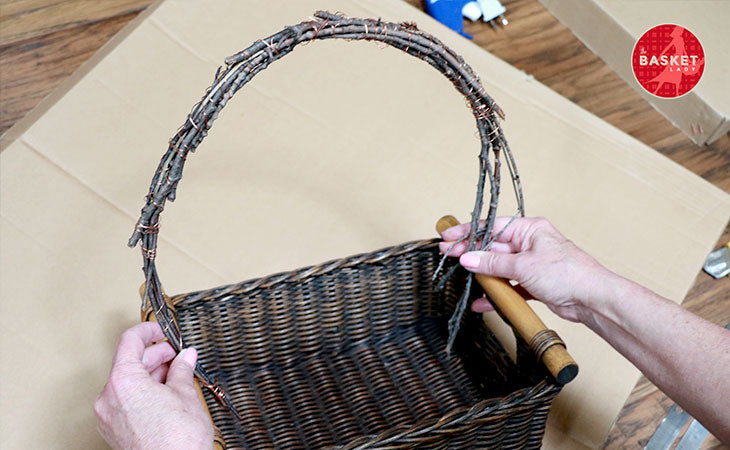 DIY Wishing Well: Bend the twig bundle and do the same on the other side.