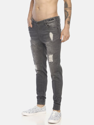 Skninny denim with zips/multiple pockts and patchs