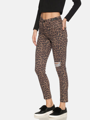 High Waisted Jeans With Leopard Print All Over And Distress Cut On One Knee