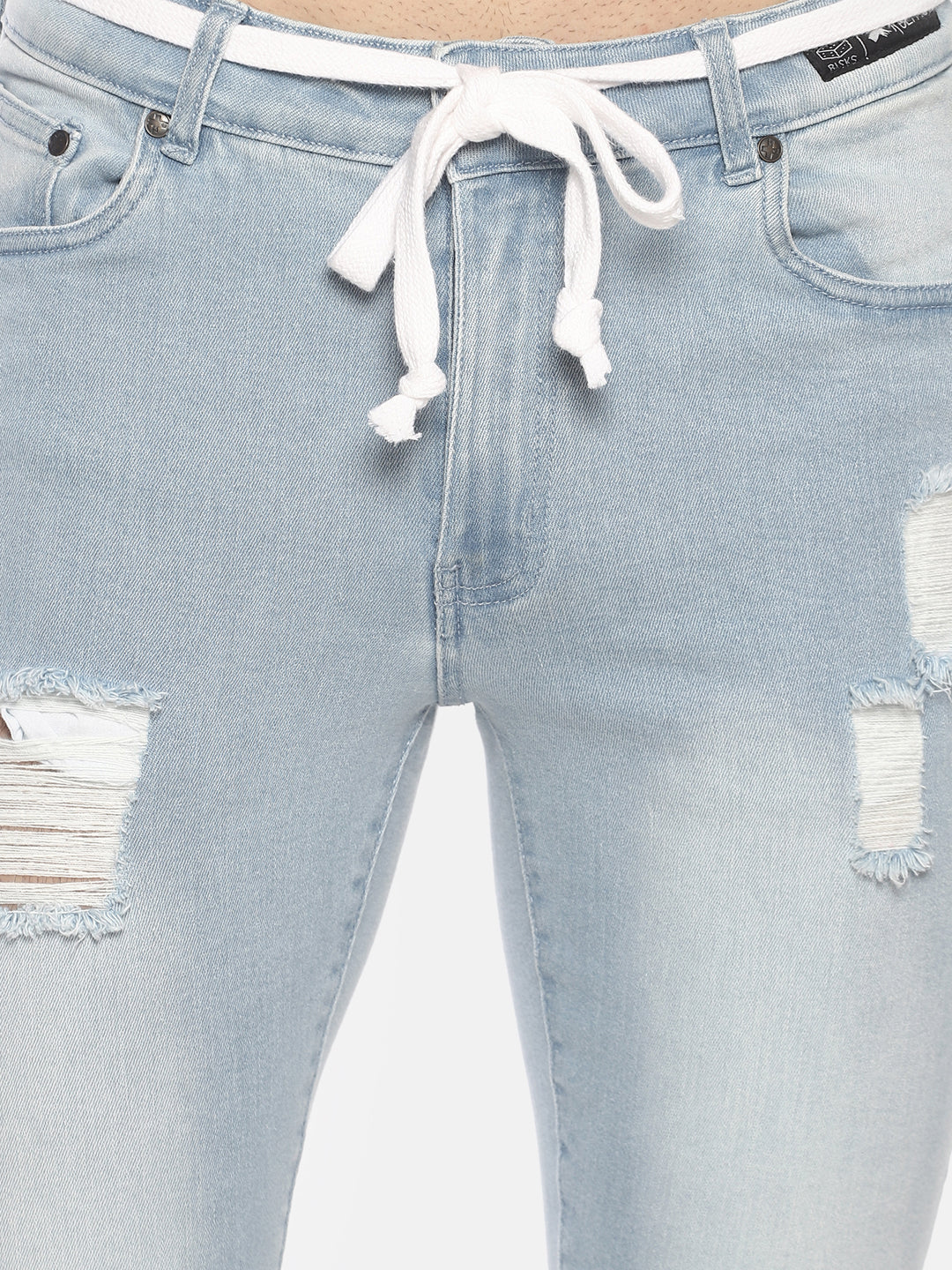 Skinnny denim with tape and distress with bullet hole distress