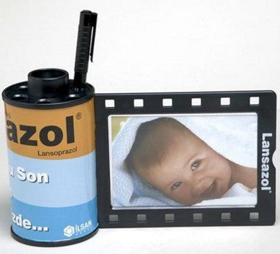 film reel canister pen pot and photo frames | Adband
