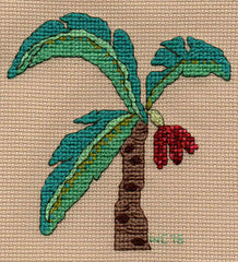 Date palm tree by Wendy Christine at Raspberry Lane Crafts pictures three aqua-green fronds and three date bunches growing from a brown trunk.