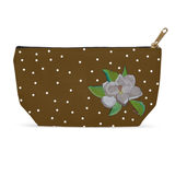 Magnolia Tree Blossom carry-all zipper bag features a white flower with green leaves on brown bag with white dots.  Adorable bag for sale at Raspberry Lane Crafts.